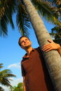 Man and Palm Tree Stock Photography