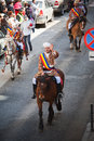 Man on parade waving to viewers celebration of brasov city days and juni horseman poarta schei street Royalty Free Stock Images