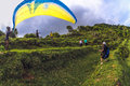 Man paragliding in Bal Stock Image
