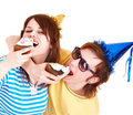 Man in party hat and girl eating cake. Royalty Free Stock Photo