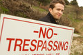 A Man Passing No Trespassing Sign Stock Photo
