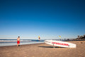 A man passing by the side of a lifeguard s surfboard gold coast queensland australia july in gold coast queensland Stock Photos