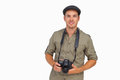 Man in peaked cap holding camera on white background Stock Images