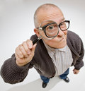 Man peering through magnifying glass Royalty Free Stock Photo