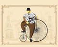 Man on penny farthing bicycle on old city background. Vector ill Royalty Free Stock Photo