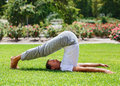 Man performing yoga in the park Royalty Free Stock Photo