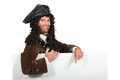 Man in a period highwayman costume with board blank for your message Stock Photo