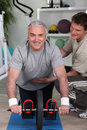 Man with personal trainer grey haired men Stock Images