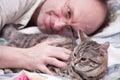 Man pets a Scottish-straight gray cat Stock Photo