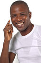 Man on phone african american talking smiling Stock Photo
