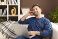 Man on the phone handsome working at home Royalty Free Stock Image