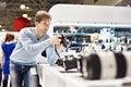 Man photographer tests digital SLR camera in shop Royalty Free Stock Photo