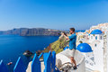 Man photographing  landscape in Santorini Royalty Free Stock Photo