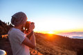Man photographing sunset beautiful landscape above the clouds on the Stock Photos