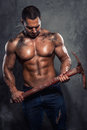 Man with pickaxe muscular handsome holding Royalty Free Stock Photo