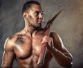 Man with pickaxe muscular handsome holding Stock Images