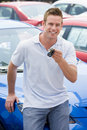 Man picking up new car Royalty Free Stock Photo