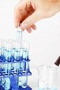 Man picking up sample in test tube Stock Photos