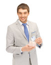 Man with piggy bank and money picture of handsome Royalty Free Stock Photo