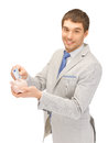 Man with piggy bank and money picture of handsome Royalty Free Stock Photography