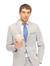 Man with piggy bank picture of handsome Royalty Free Stock Images