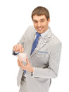 Man with piggy bank picture of handsome Stock Photo