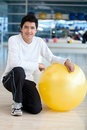 Man with pilates ball Stock Photos