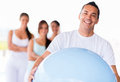 Man with a pilates ball portrait of men looking happy Stock Photos