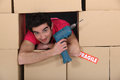 A man through a pile of boxes Stock Photography