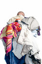 Man with a pile of clothes Royalty Free Stock Photo