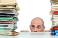 Man with piles of folders Royalty Free Stock Photo