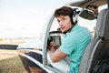 Man pilot sitting in cabin of small airplane Royalty Free Stock Photo