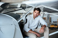 Man pilot sitting in small airplane Royalty Free Stock Photo
