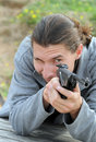 The man with a pistol. Stock Images