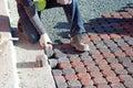 Man Placing Paving Stones