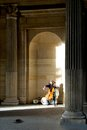 Man play cello for monet at the louvre playing money museum in paris france Royalty Free Stock Images