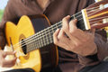 Man playing acoustic guitar midsection closeup of Royalty Free Stock Image