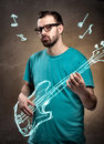 Man playing air guitar with glasses and beard imaginary Stock Photo
