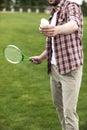 Man playing badminton on green field Royalty Free Stock Photo