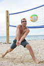 Man playing beach volleyball game hitting ball forearm pass volley on summer male model living healthy active lifestyle Royalty Free Stock Image