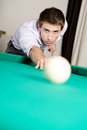 Man playing billiards at gambling house spending free time on Royalty Free Stock Images