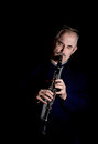 Man playing the clarinet jazz Stock Photography