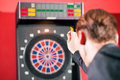 Man playing darts Stock Photos