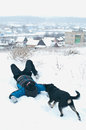 Man playing with dog at winter field shallow dof focus on Stock Photo