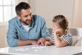 Man playing domino with daughter Royalty Free Stock Photo