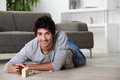 Man playing with dominoes at home Royalty Free Stock Photo