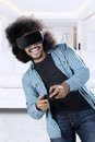 Man playing game with virtual reality glasses