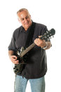 Man playing guitar middle aged black electric shot on white background Royalty Free Stock Photo