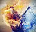 Man playing the guitar into music and Stock Image