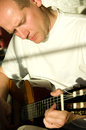 Man playing in guitar portrait of acoustic Royalty Free Stock Image